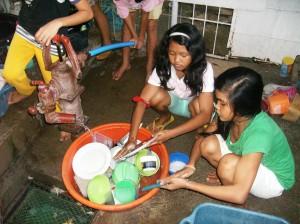 Jessibel and Cyril Washing Dishes